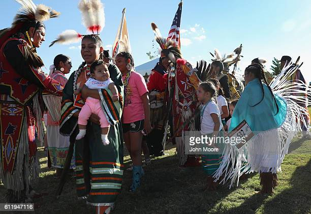 "Native Americans take part in the grand entry of traditional dancers at the ""Rocking the Rez"" Pow Wow on October 1, 2016 in Ysleta del Sur Pueblo,..."