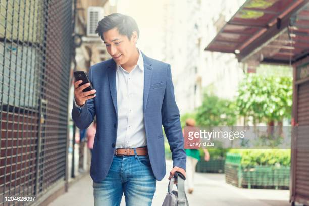 native argentinian man walking to work - minority groups stock pictures, royalty-free photos & images