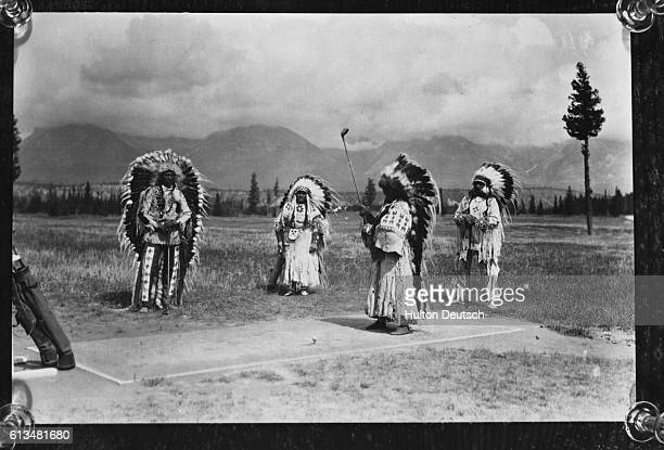 Native Canadian chiefs Sitting Eagle, and Black Buffalo and their wives play a round of golf at Banff Springs in 1927. The chiefs and Mrs. Black...