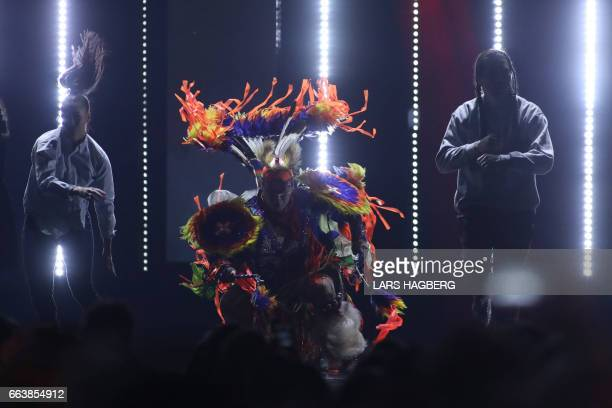 Native dancers perform during the JUNO Awards at the Canadian Tire Centre in Ottawa Ontario on April 2 2017 / AFP PHOTO / Lars Hagberg