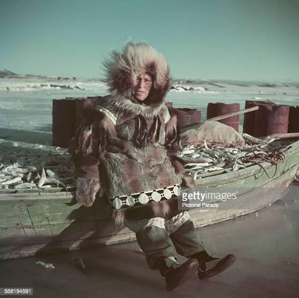 A native fisherman with a boat full of fish in Alaska USA circa 1965