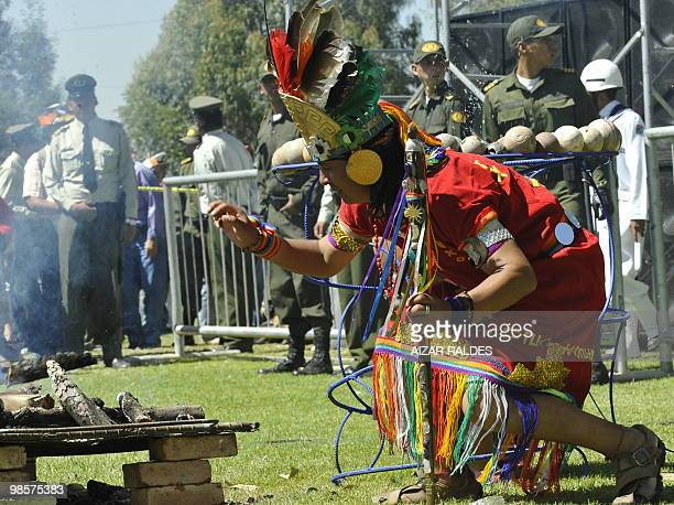 A native from an indigenous tribe from Peru makes a ritual during the inauguration ceremony of the People's World Conference on Climate Change and...