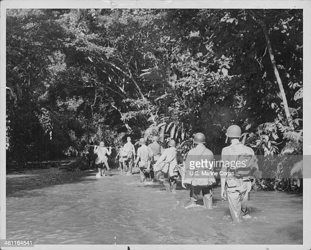 Native guides lead US Marines up the Tenaru River in the jungles of Guadalcanal, on a mission to destroy two Japanese artillery pieces, Solomon...