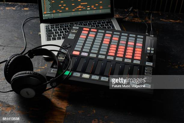 A Native Instruments Maschine Jam sampler Apple MacBook laptop and a pair of AKG headphones taken on August 30 2016