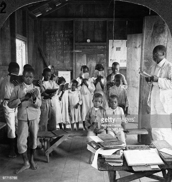 Native Jamaican school children reciting in the rough school house Jamaica