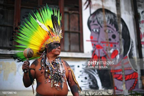 Native Korubo Isolado from the Brazilian state of Acre poses at the abandoned and crumbling Indian Museum complex near the National Museum where on...