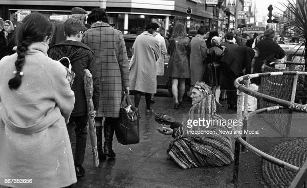 Native Musician Busking on O'Connell Street where Nelson's Pillar used to be circa January 1971