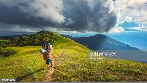 Native sherpas man working on mountain
