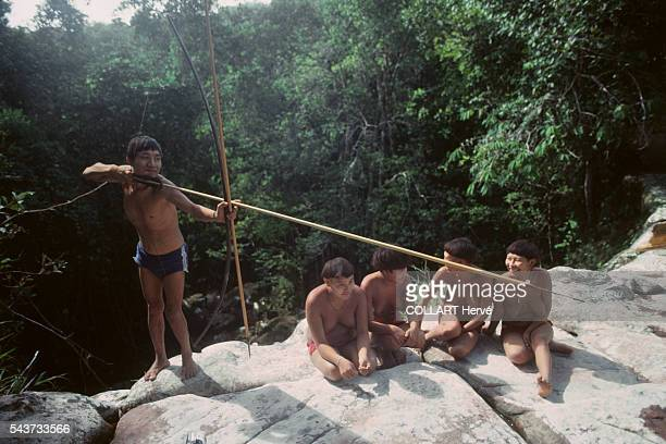 Native South Americans living close to the Amazon River in Brazil The Yanomami are an indigenous people of Brazil and Venezuela living under the...