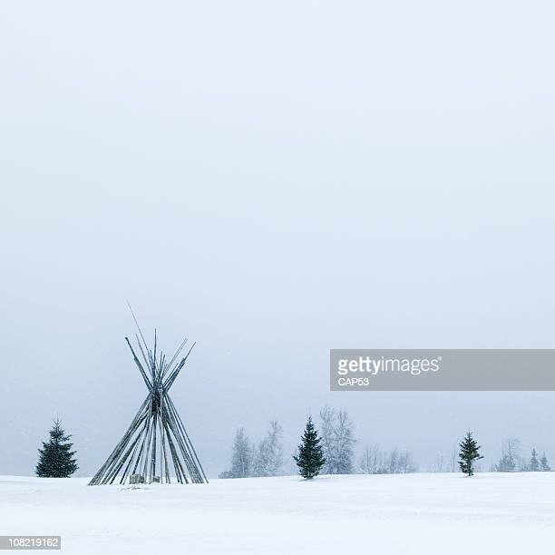 Native Tepee Frame During Winter Snowstorm