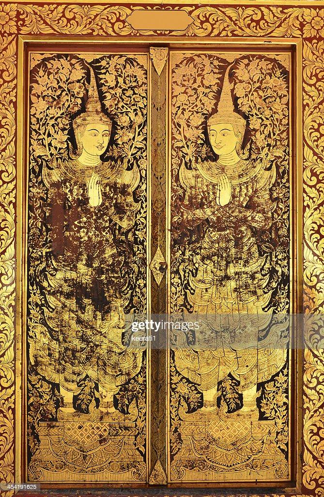 Native Thai style of pattern on door temple : Stock Photo