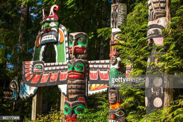 native totem pole in bc - stanley park vancouver canada stock photos and pictures