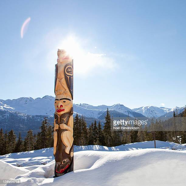 Native totem pole in Whistler near mountains