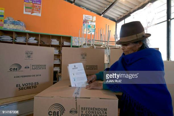 A native woman from Cangahua northeast of Quito casts her vote at a polling station set at a school during a referendum called by President Lenin...