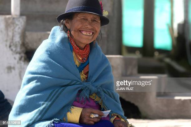 A native woman from Cangahua northeast of Quito is pictured outside a polling station set up at a school during a referendum called by President...