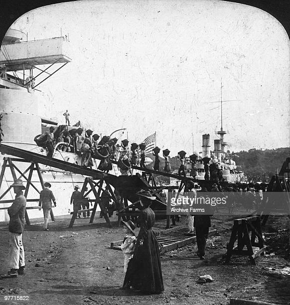 Natives carrying coal onboard a US warship at Castries St Lucia