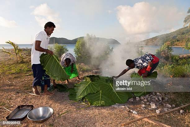 Natives cooking with Lovo Oven, Makogai, Lomaviti, Fiji