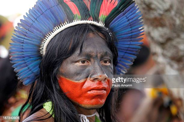 CONTENT] Natives of several tribes take part in an ceremony to bring attention to saving the Amazon forest in Belem in Para in the heart of the...