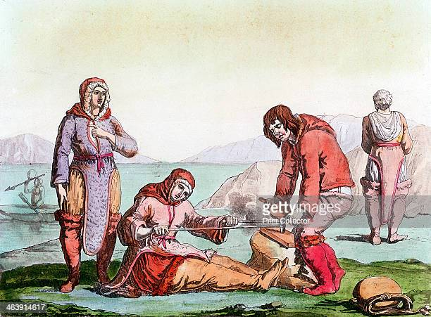 Natives of the Arctic, 1825-1835. People dressed in animal skins, using a thong drill to make fire . From Costume Antico et Moderno. .