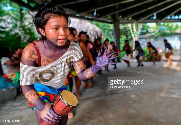 Natives of the Embera ethnic group dance at the Ipeti Embera community near Torti Chepo district Panama on October 15 2019 On October 16 the Embera...