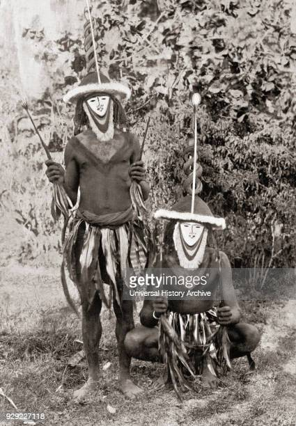 Natives of The Gazelle Peninsula New Britain Papua New Guinea wearing spirit masks After a 19th century photograph From Customs of The World...