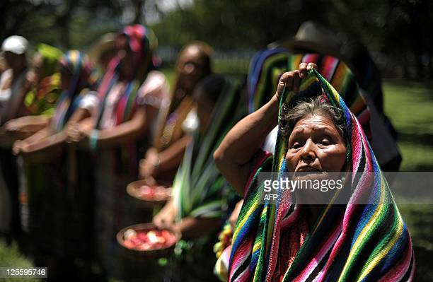 Natives of the Nahua Pipil ethnic group take part in a ceremony to celebrate the autumn solstice in the Cihuatan archeological site 36 km north from...