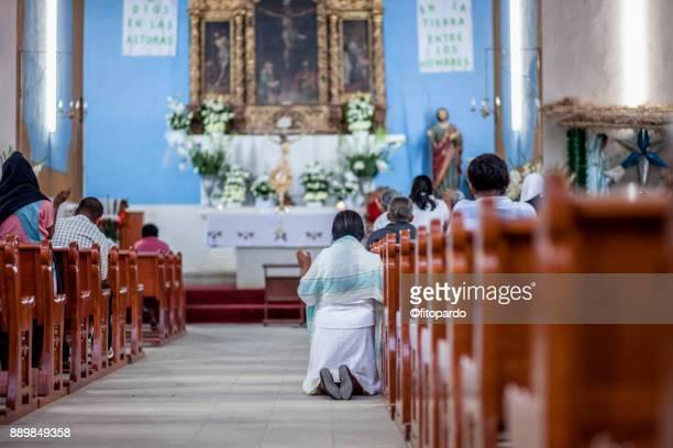 Natives praying in church