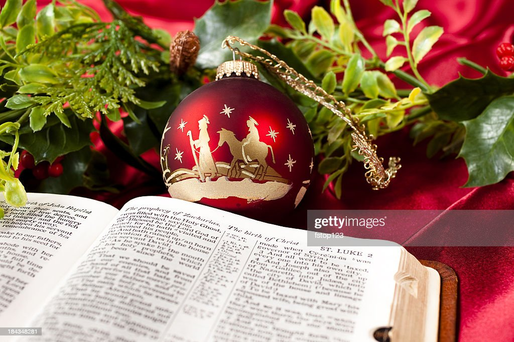 Nativity red Christmas ornament.  Open Bible. Garland. St. Luke. : Stock Photo