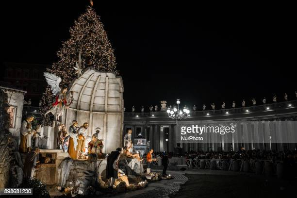 Nativity scene and' Christmas tree in St Peter's Square on December 252017 in Vatican City Vatican set up in the centre of St Peter's Squarein...