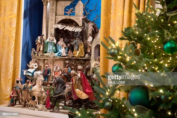A Nativity scene and Christmas trees are seen during a preview of holiday decorations in the East Room of the White House in Washington DC November...