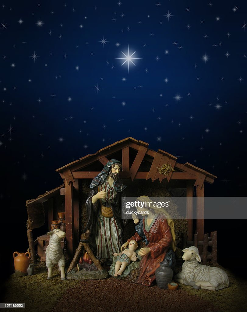 Nativity Scene At Night With Stable