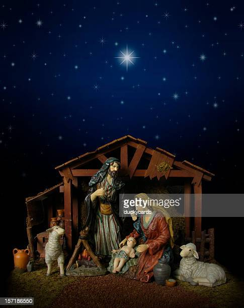 nativity scene at night (with stable) - nativity stock photos and pictures