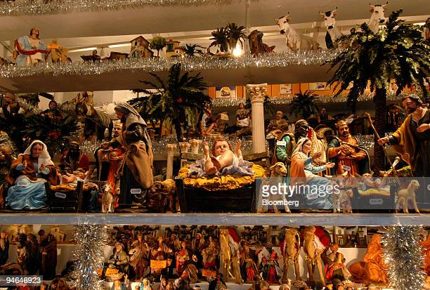 Nativity scene figures are sold in the Christmas market in Piazza Navona in Rome Italy on Friday Dec 7 2007 The Christmas retail shopping period is...