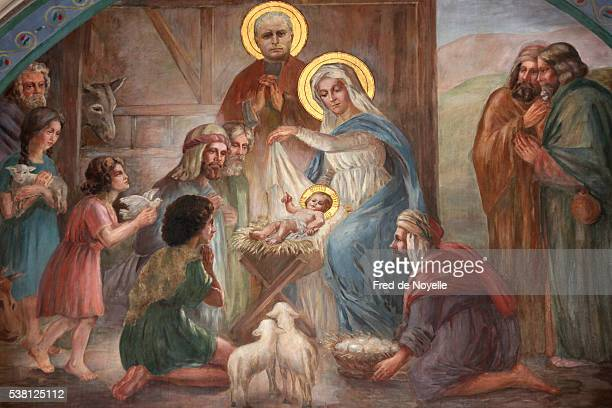 nativity scene fresco in saint joseph des nations church - nativity stock photos and pictures