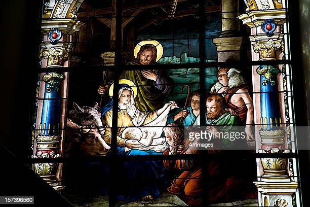 nativity scene on stained glass window - manger stock photos and pictures