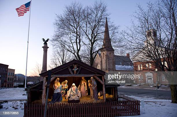nativity scene on the town common with american flag, war memorial, church, and the town hall in background, greenfield, ma - jesus is alive stock pictures, royalty-free photos & images