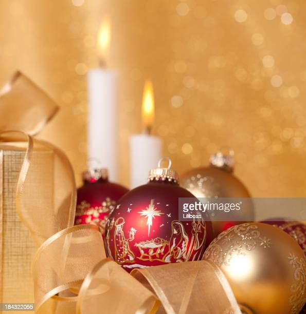 nativity scene ornaments and christmas candles - manger stock photos and pictures