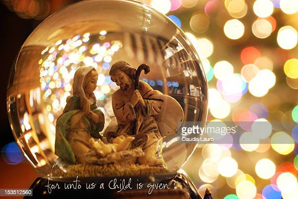 nativity scene snow globe globe bokeh lights reflections Christmas