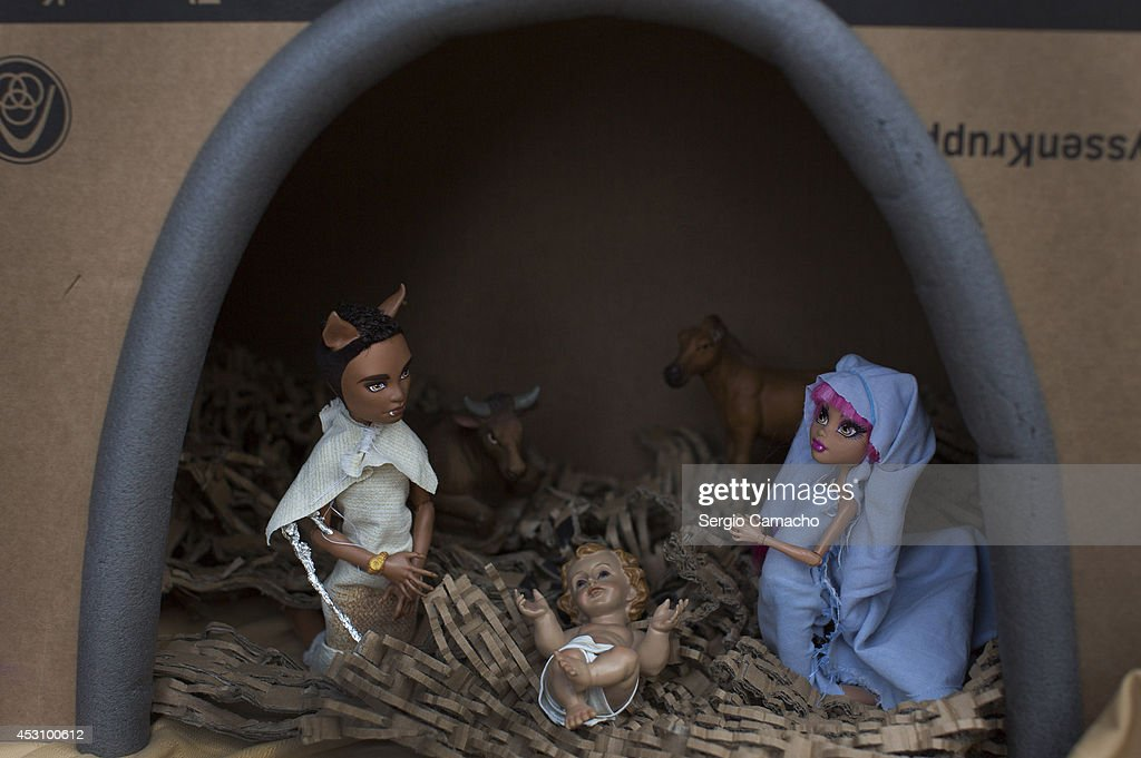 Nativity scene with Monster High dolls is displayed during the New Year's Eve in August celebrations on August 2, 2014 in Berchules, Spain. The town of Berchules, located in Granada, on the southern slope of the Sierra Nevada Mountain Range, has had a curious New Year's Eve tradition in place since 1994. The town experienced a power outage on New Year's eve in 1994 and residents were unable to hold the traditional celebrations, so they decided to move their celebrations to the mid-point of the year, holding them in August instead.