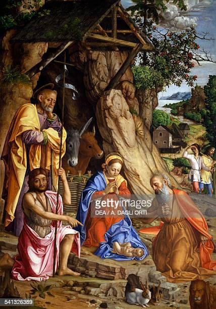 Nativity with rabbits ca 1500 by Gerolamo dai Libri oil on canvas 217 x 151 cm Verona Castelvecchio