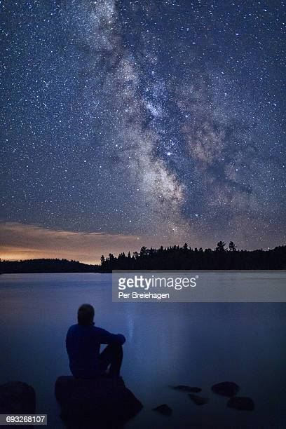 a man looking at the milky way_voyageurs natl park - minnesota stock pictures, royalty-free photos & images