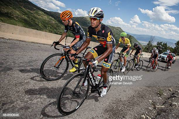 Natnael Berhane of the MTN-Qhubeka team leads Michael Woods of the Optum Pro Cycling team and Joe Dombrowski of the Cannondale-Garmin Pro Cycling...