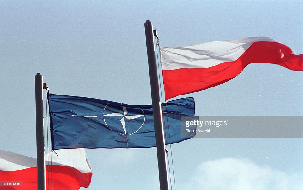 NATO And Polish Flags In Front Of The Polish Parliament Building As An Official Sign That Poland Is : News Photo