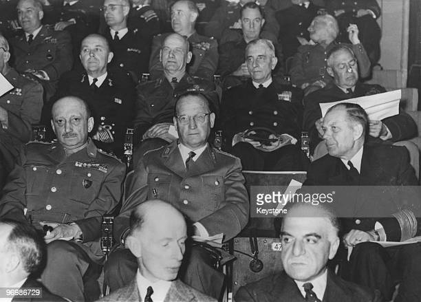 Nato Generals attend the opening of command exercise CPX7 at Supreme Headquarters Allied Powers Europe Belgium 15th April 1957 Middle row left to...