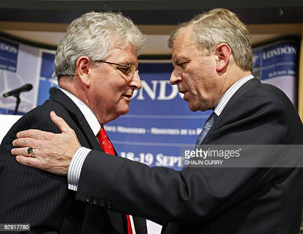 Nato SecretaryGeneral Jaap de Hoop Scheffer and British Defence Minister Des Browne speak after adddressing a press conference in central London on...