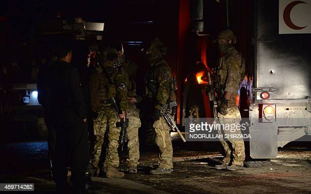 Led International Security Assistance Force soldiers arrive to investigate the site of a suicide attack at the foreign aid workers' guesthouse in...