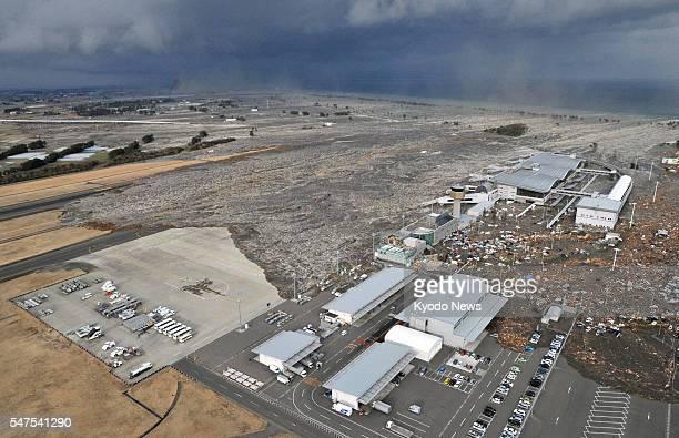 Natori Japan A massive tsunami engulfs Sendai airport in Miyagi Prefecture northeastern Japan on March 11 after a major earthquake hit the area...