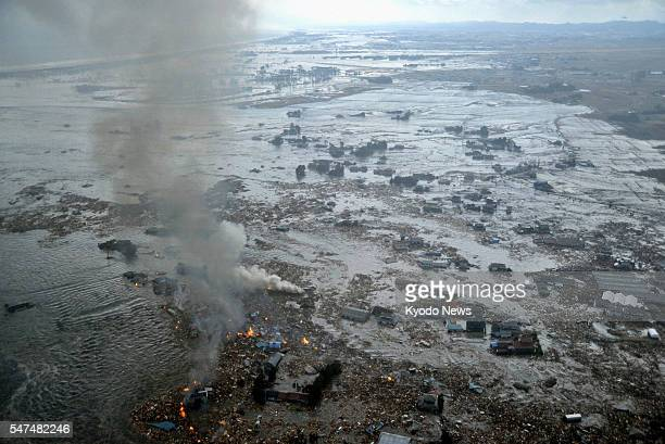 Natori Japan Photo taken on March 11 from a Kyodo News helicopter shows a coastal area near Natori Miyagi Prefecture inundated after a powerful...