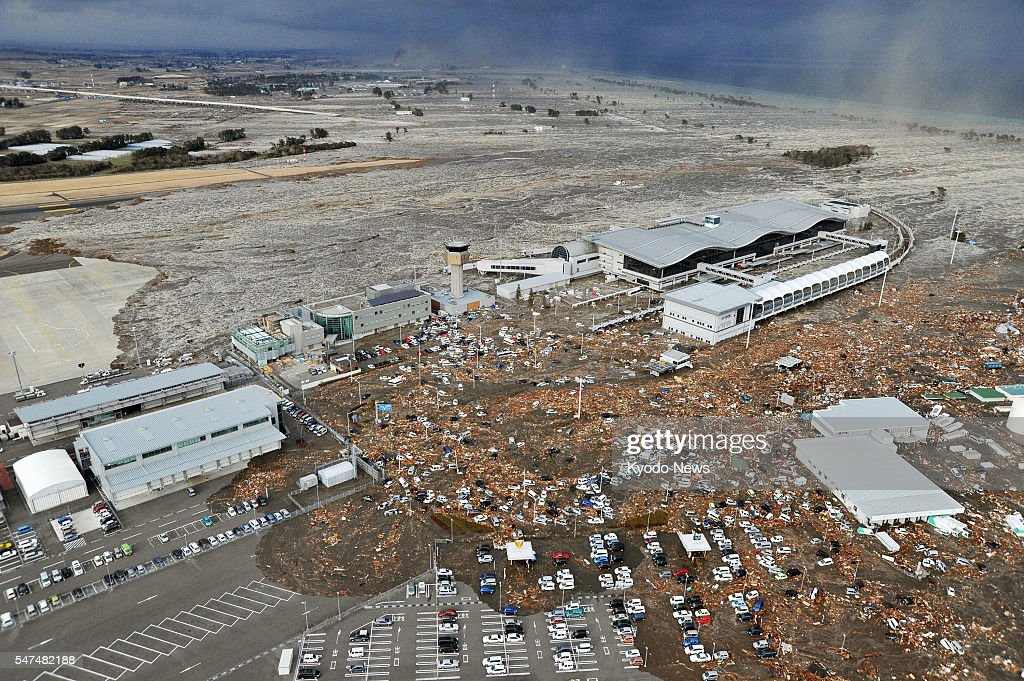 Natori, Japan - Sendai airport in Miyagi Prefecture, northeastern Japan, is seen swamped by a tsunami after a powerful quake in a photo taken from a Kyodo News helicopter on March 11, 2011.
