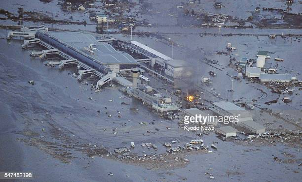 Natori Japan Sendai airport is submerged after a tsunami following a powerful quake in a photo taken from a Kyodo News helicopter in Miyagi...